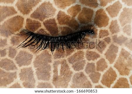 Women eye, close-up, concept of sadness, giraffe pattern - stock photo