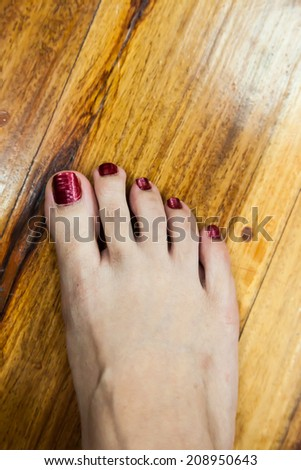 women feet after pedicure with red nails background - stock photo