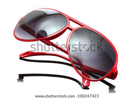 Women glamorous red sunglasses on grey background - stock photo