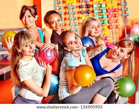 Women group in aerobics class.  Fitness ball. - stock photo