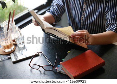women hand hold book for reading knowledge - stock photo