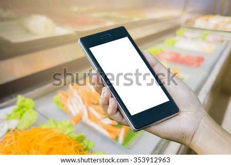 Women Hand holding smart phone with food online device on screen over blur  japanese restaurant background, food online, food delivery concept - stock photo