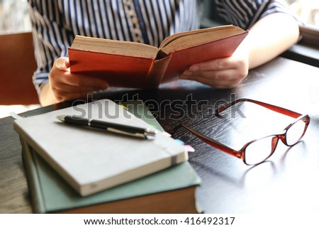 women hand open book for reading - stock photo