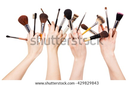 Women hand with cosmetic brushes for makeup isolated on white background. - stock photo