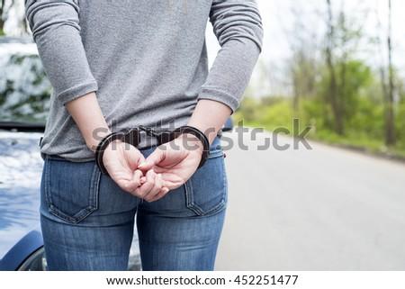 Women handcuffed criminal police - stock photo