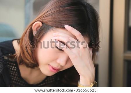 Women having headache, migraine, hangover, insomnia. - stock photo