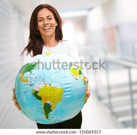 Women holding a globe, indoor - stock photo