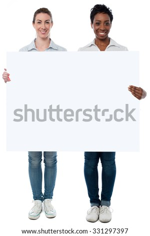 Women holding a whiteboard, copy space area. - stock photo
