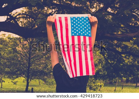 women holding American flag in style tone vintage. - stock photo