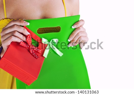 Women holding surprise bags ,isolated on white - stock photo