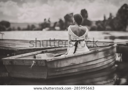 "Women in a boat. This image was created with the method called ""bokeh panorama"".Multiple images was fitted together to became a great field of view with a shallow depth of field, in high resolution - stock photo"