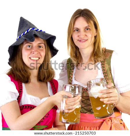 Women in dirndl clinking glasses - stock photo