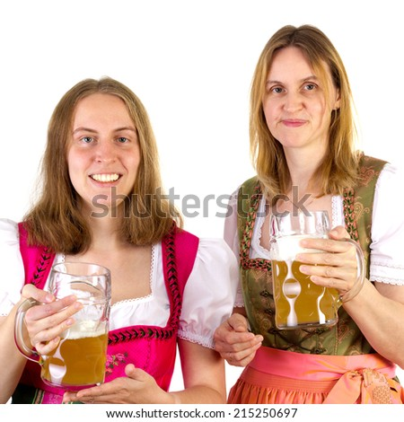 Women in dirndl presenting double beer - stock photo