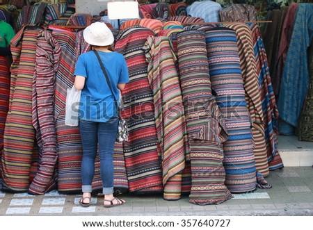 women in fabric shop - stock photo