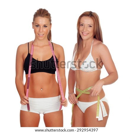 Women in lingerie with tape measures isolated on a white background - stock photo