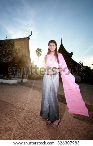 Women in thai dress at the old temple - stock photo