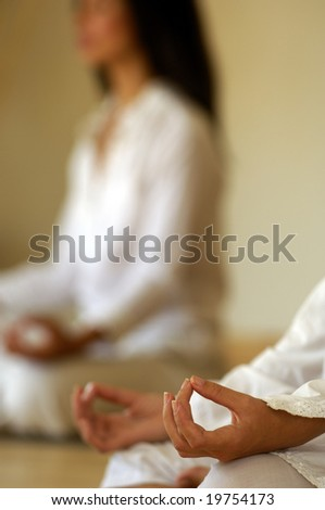 Women in yoga position - stock photo