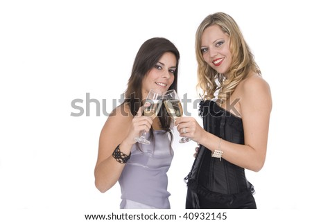 women laughing in new year celebration with champagne - stock photo