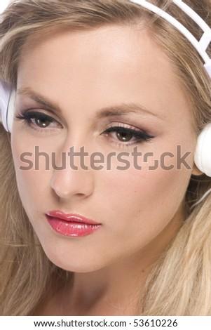 women listenig to music in white headphone - stock photo