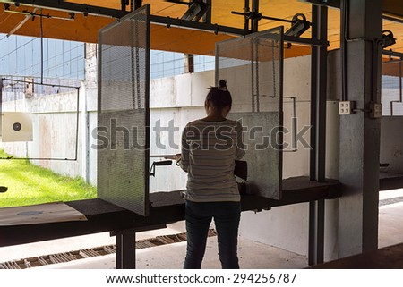 women load rifle bullet  for shooting target. - stock photo