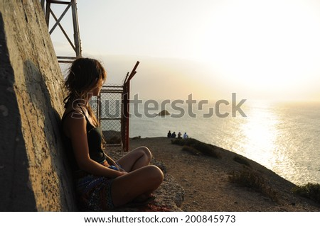 Women looking at Sunset over the Ocean, Guajira, Colombia. Beautiful Desert.  - stock photo