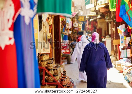 Women on Moroccan market (souk) in Fes, Morocco - stock photo
