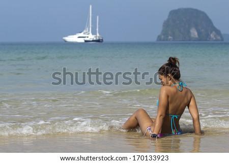 women on the beach  - stock photo