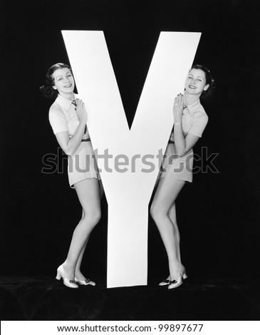 Women posing with huge letter Y - stock photo