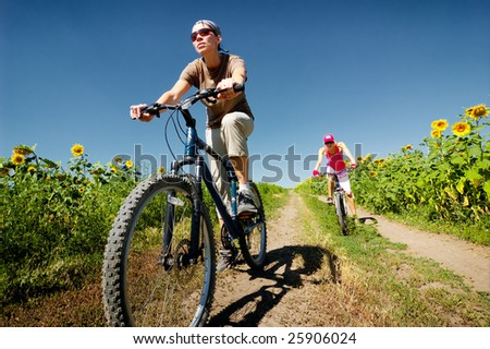 women relax biking on summer road - stock photo