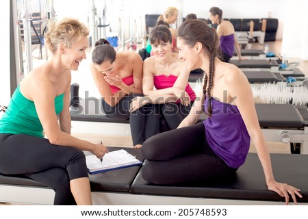 Women relaxing in the gym after training - stock photo