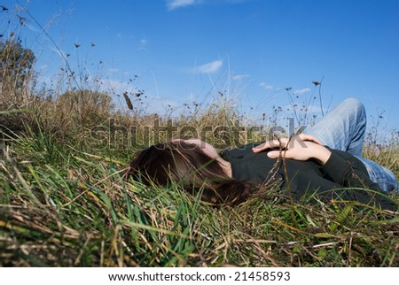 Women relaxing on the grass - stock photo