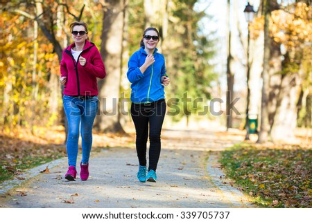 Women running  - stock photo