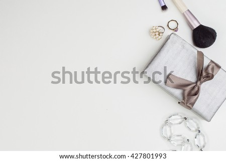 Women's accessories and cosmetics. Top view photo of glamour objects with free space for logo. There are gift and makeup brush - stock photo
