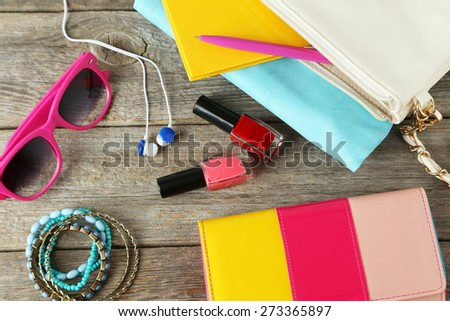 Women's accessories on a grey wooden background - stock photo