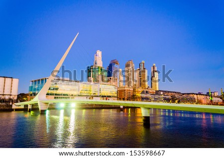Women's Bridge and upscale skyscrapers at night in Puerto Madero neighborhood of Buenos Aires - stock photo