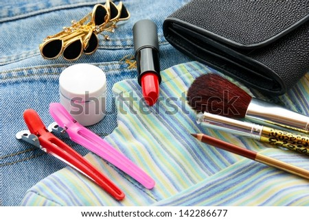 Women's clothes and cosmetics. - stock photo