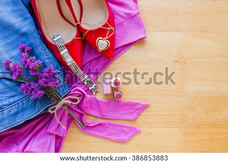 Women's clothing and accessories on wooden table background - stock photo