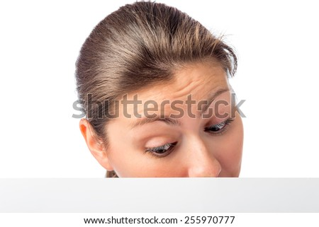 Women's curious eyes looking down on poster - stock photo