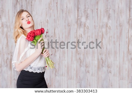 Women's Day, a young woman with flowers - stock photo