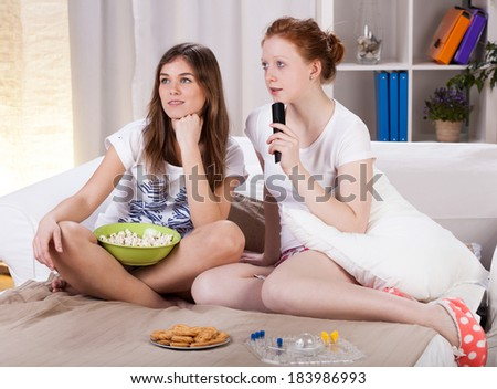 Women's evening with movie and snacks, horizontal - stock photo