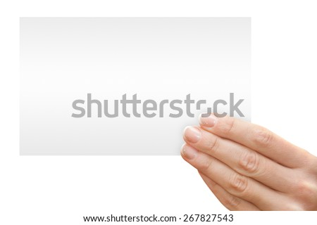 Women's fingers holding a blank white card - stock photo