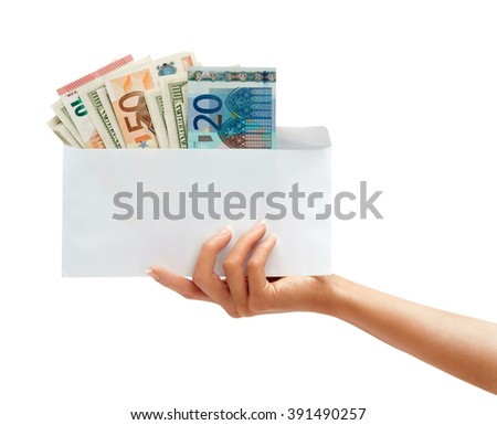Women's hand holding out an envelope full of euro and dollars. Business concept - stock photo