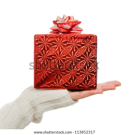 Women's hands hold out a box with a gift on a white background. - stock photo