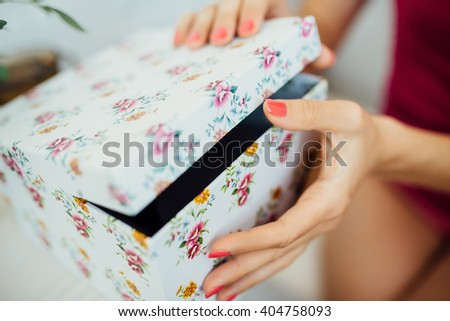 women's hands open a box - stock photo
