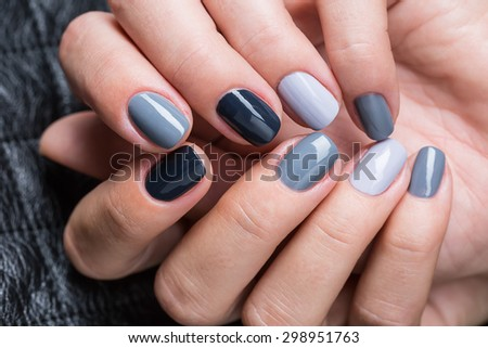 Women's hands with a stylish manicure. - stock photo