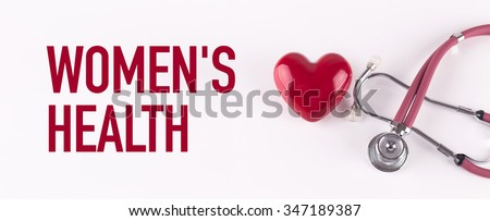 WOMEN'S HEALTH concept with stethoscope and heart shape - stock photo
