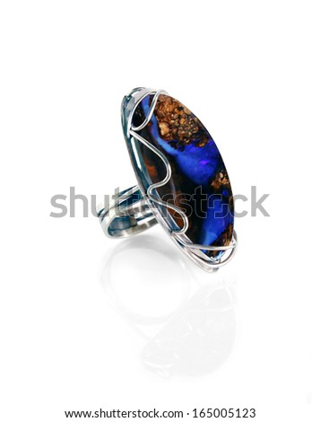 Women's jewelry silver ring with opal - stock photo