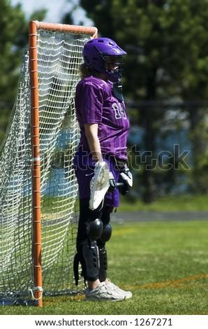 Women's lacrosse goalie - stock photo