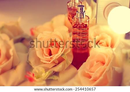 Women's perfume in beautiful bottle - stock photo