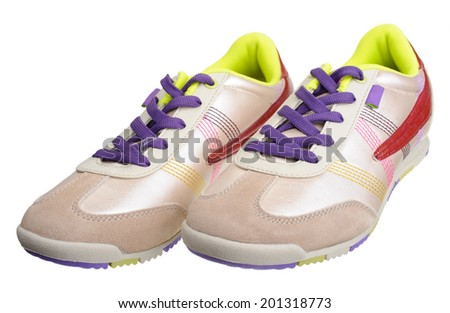 Women's sneakers, isolated on a white background. - stock photo